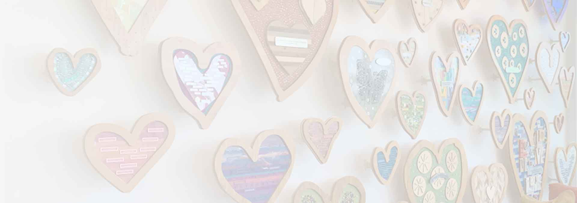 Faded background image of heart shaped plaques
