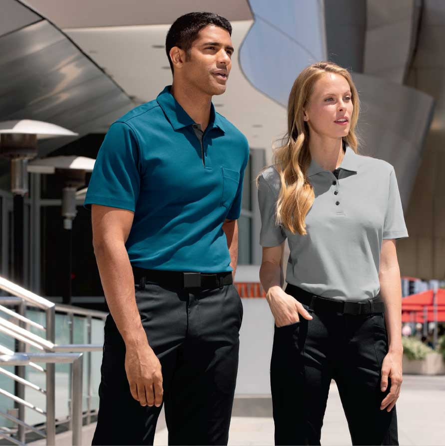 Male and female executives standing wearing executive apparel