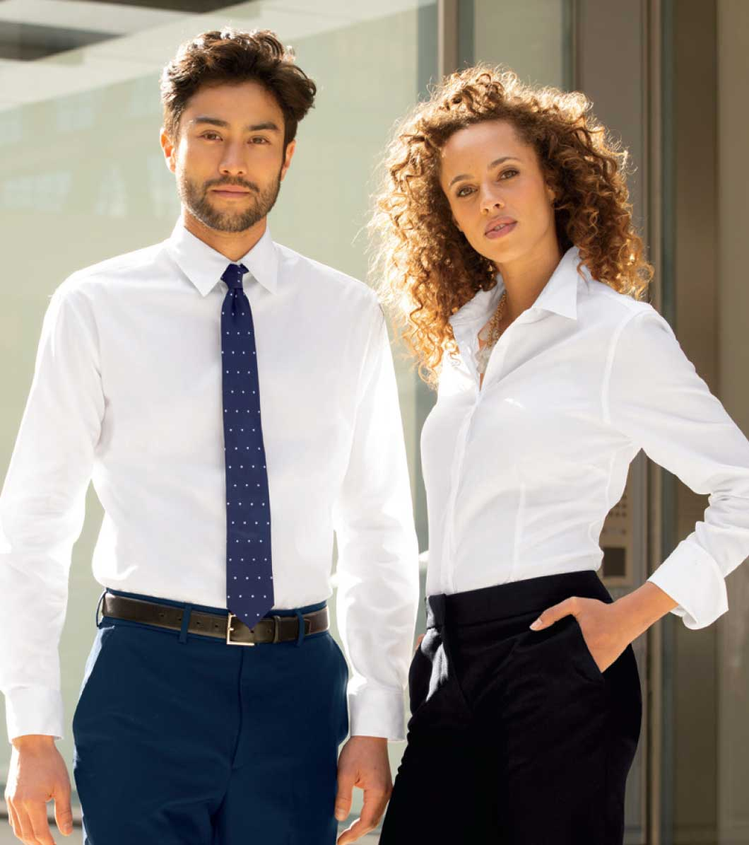 image of standing executives in executive apparel