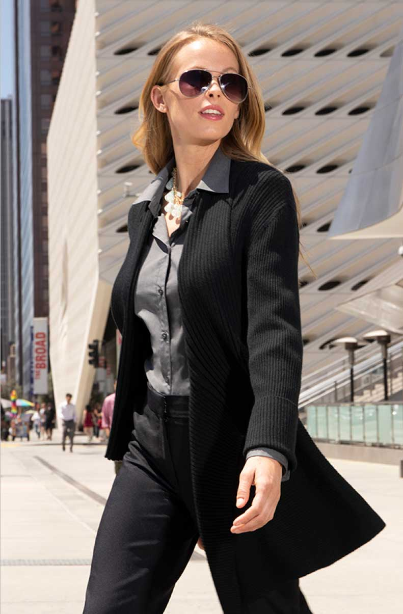 Image of woman standing wearing executive apparel